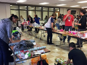 HHS students wrap gifts for families in need