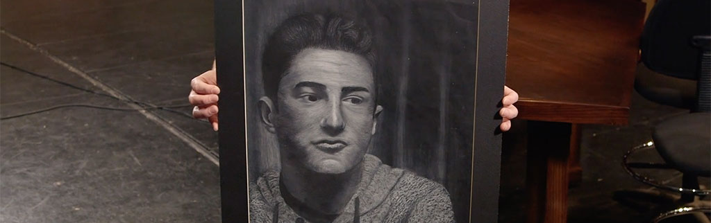 Student Displays Self Portrait